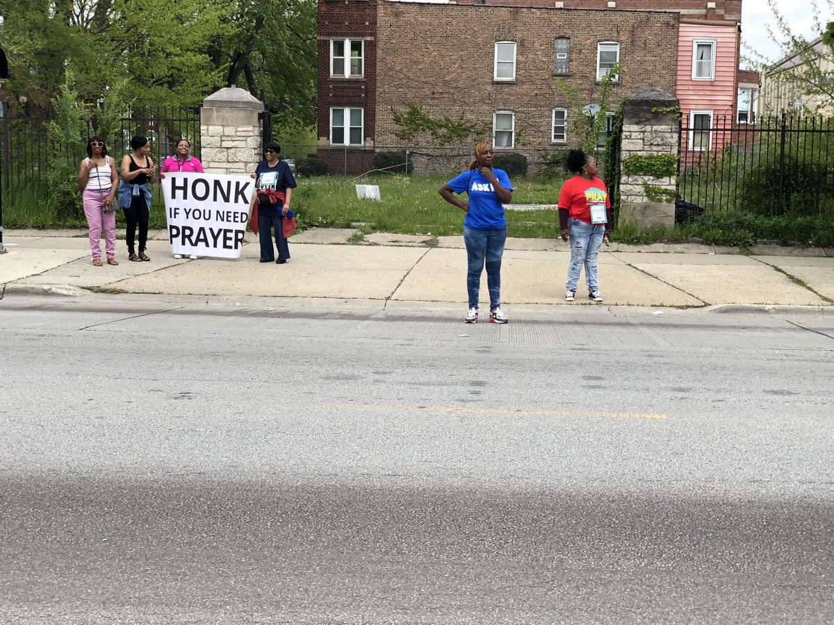 Community members on Saturday along the route of the Prayer on the 9 anti-violence march.