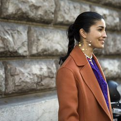 Caroline Issa in a Hugo Boss coat, Nina Ricci blouse, and Peter Jensen earrings.