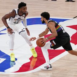Utah Jazz's Donovan Mitchell (45) defends as Denver Nuggets' Jamal Murray (27) advances the ball down court during the second half an NBA first round playoff basketball game, Tuesday, Sept. 1, 2020, in Lake Buena Vista, Fla.