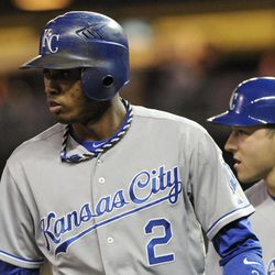 Kansas City Royals' Alcides Escobar, left, and David Lough watch the play after they scored on a two-run single to left by Billy Butler in the fifth inning off Minnesota Twins pitcher P.J. Walters in a baseball game on Wednesday, Sept. 12, 2012, in Minneapolis.