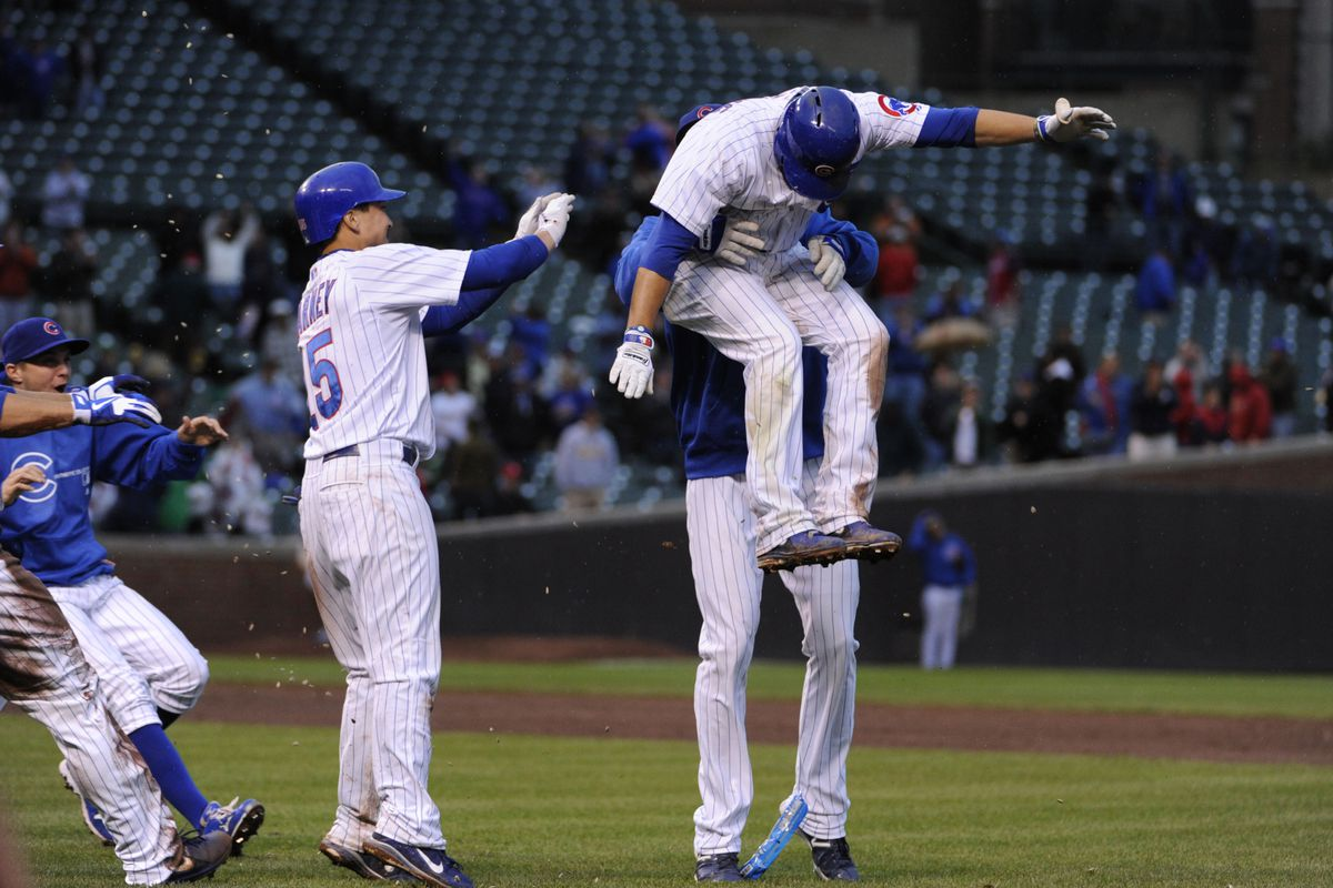 Chicago, IL, USA;  Chicago Cubs right fielder David DeJesus is lifted up by his teammates after hitting the game winning hit in the eleventh inning against the St. Louis Cardinals at Wrigley Field. Credit: David Banks-US PRESSWIRE