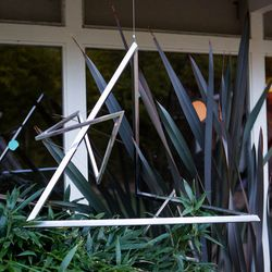 A hanging sculpture in the back garden by Forrest Myers