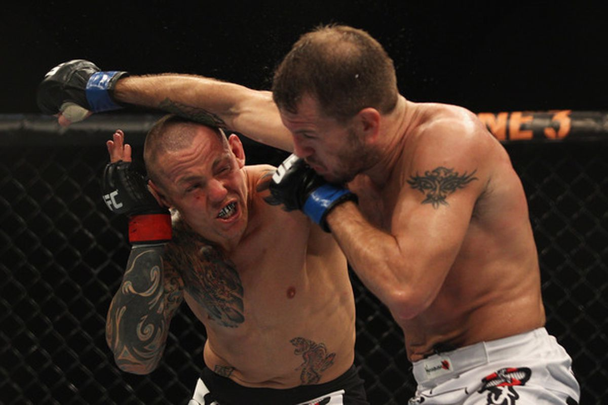 SYDNEY, AUSTRALIA:  Ross Pearson of Great Britain punches Spencer Fisher of the USA during their Lightweight bout UFC 127 at Acer Arena in Sydney, Australia.  (Photo by Mark Kolbe/Getty Images)