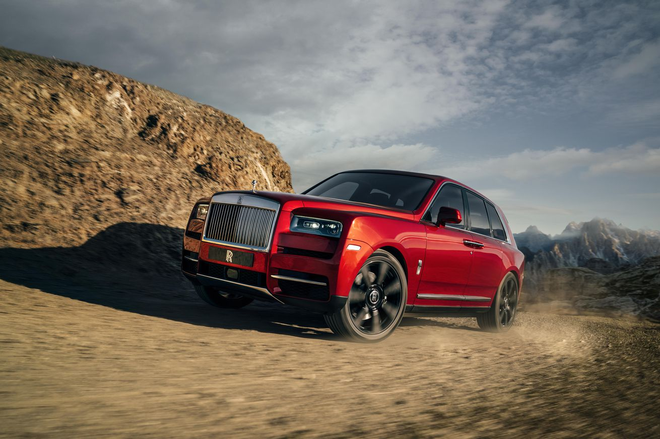 rolls royce suggests using its first suv to go volcano boarding