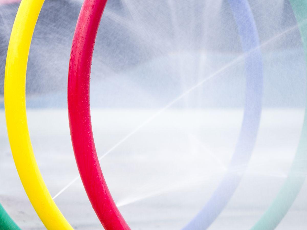 Multicolored spray rings at a splash pad.