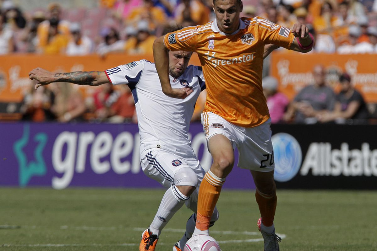 HOUSTON, TX - OCTOBER 01: Geoff Cameron #20 of the Houston Dynamo defends the ball around Daniel Paladini #11of the Chicago Fire on October 1, 2011 at Robertson Stadium in Houston, Texas. (Photo by Thomas B. Shea/Getty Images)