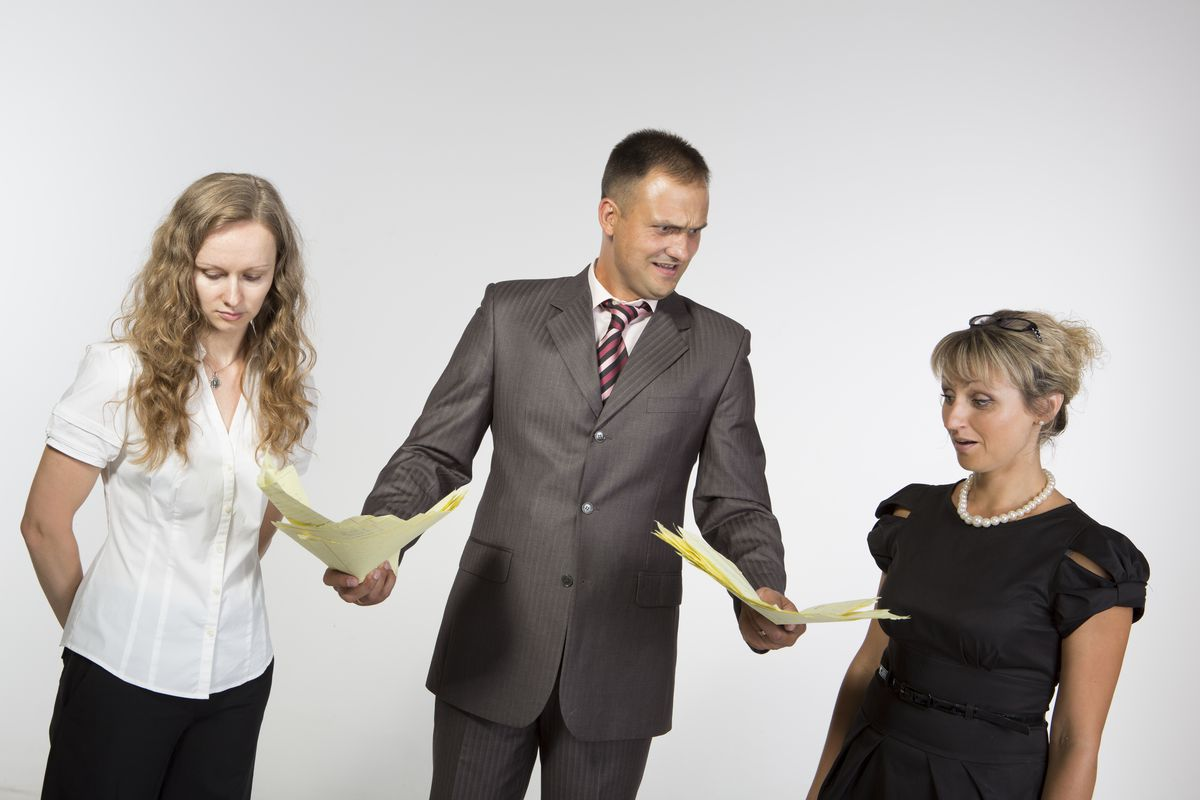A boss pressuring his employees about politics might look something like this stock photo.