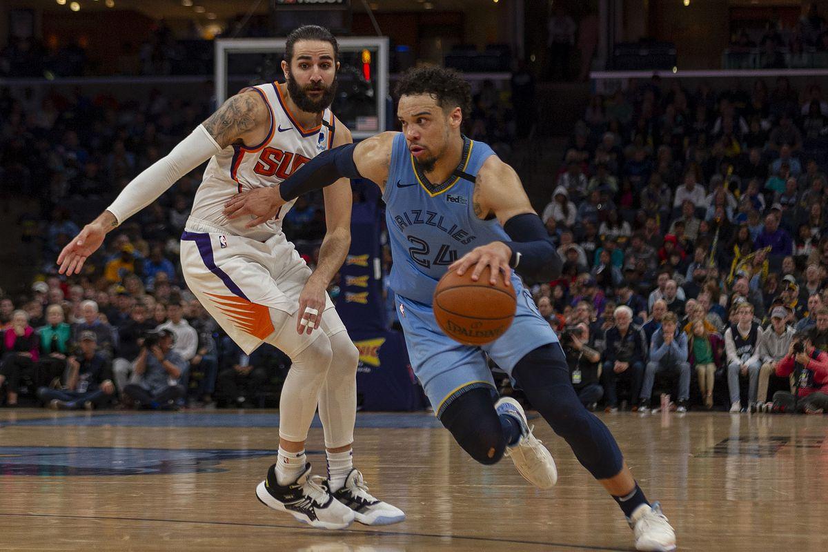 Memphis Grizzlies guard Dillon Brooks dribbles the ball around Phoenix Suns guard Ricky Rubio during the second half at FedExForum.