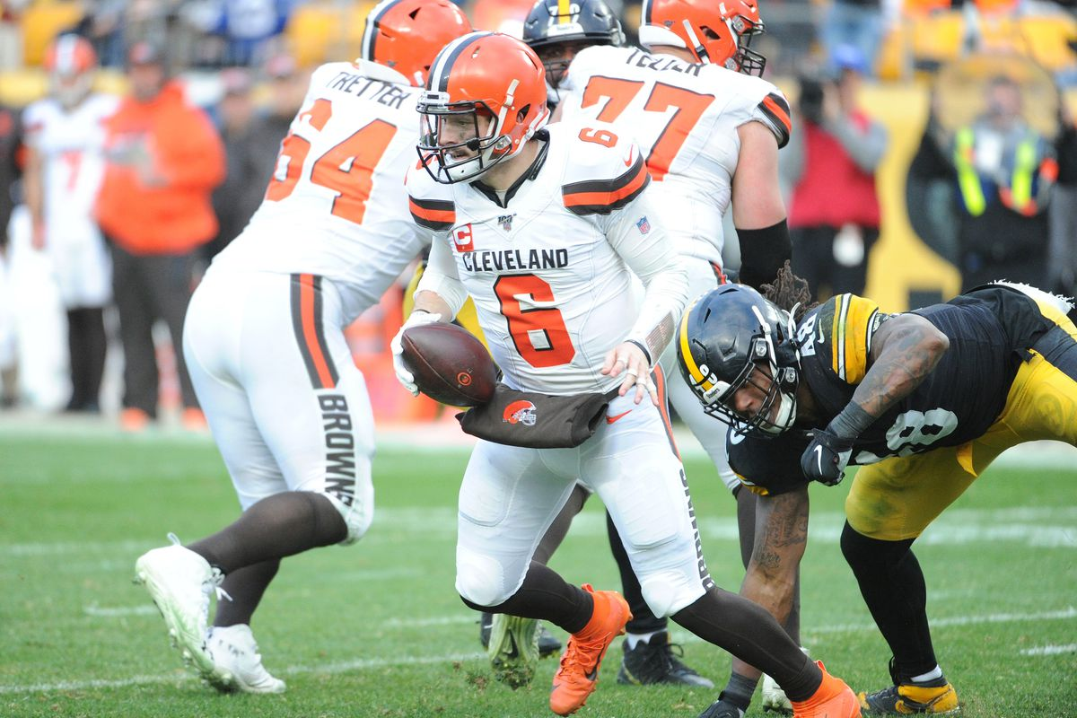 Cleveland Browns quarterback Baker Mayfield (6) is pressured by Pittsburgh Steelers linebacker Bud Dupree (48) during the fourth quarter at Heinz Field.