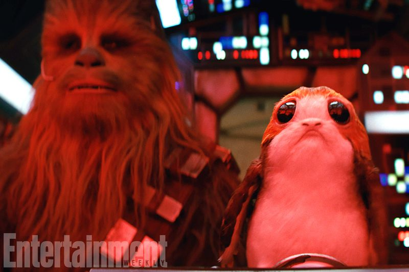 Star Wars: The Last Jedi - A porg perched next to Chewbacca in the cockpit of the Millennium Falcon