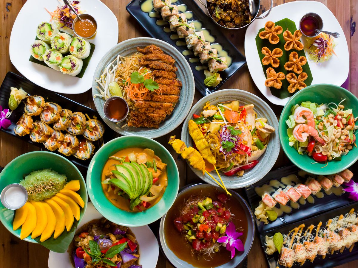 A spread of food from a Thai and Japanese restaurant, viewed from overhead