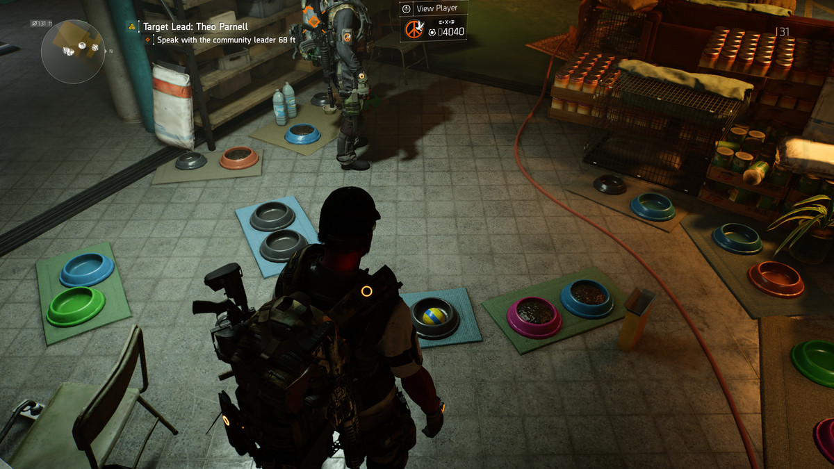 Several pet dishes on a dirty floor, surrounded by crates of donated food, in Tom Clancy's The Division 2