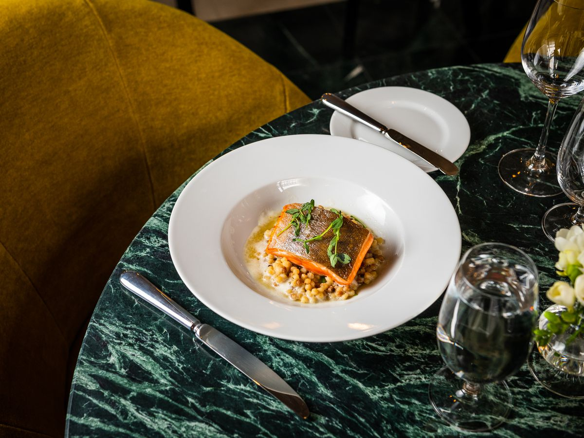 An arctic char dish with couscous, saffron, and snow peas at Cafe Riggs