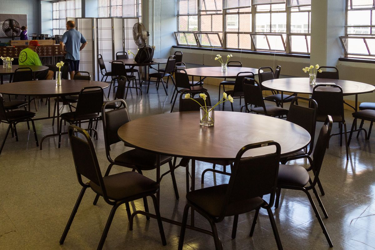 Empty tables and chairs in a teacher's lounge.
