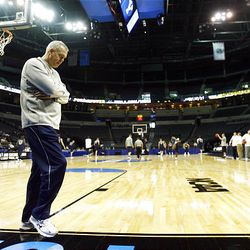BYU coach Dave Rose walks the end line as his team practices Wednesday at the Ford Center in Oklahoma City. The Cougars play Florida Thursday.