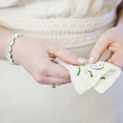 The bride wears a dress from Asos, Halogen shoes, a bracelet that her sister wore at her own wedding, and her grandmother's handkerchief.