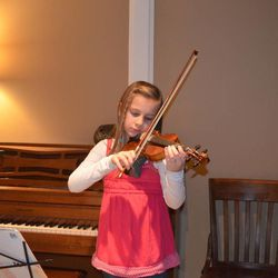 Abby McLaughlin, 8, practices violin in her Houston home on Jan. 9, 2013. Musical training is something Abby's parents find necessary.