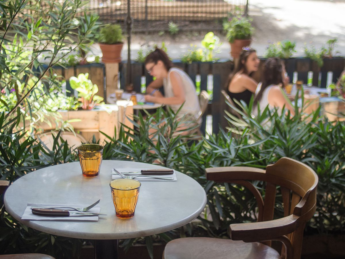 A table in the window of café Parvis, facing the outdoor patio.