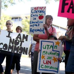 Ten-year-old Sarah Valentine of Syracuse declares that she is not common while standing with Common Core opponents at the State Board of Education office in Salt Lake City on Friday, Aug. 2, 2013.