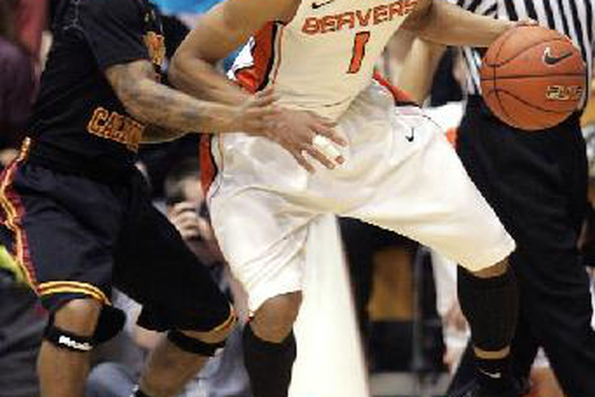 Jared Cunningham didn't disappoint Oregon St. fans, including Gary Payton, scoring 18 points and handing out 5 assists to lead the Beavers to a 78-59 win over USC. <em>(AP Photo)</em>