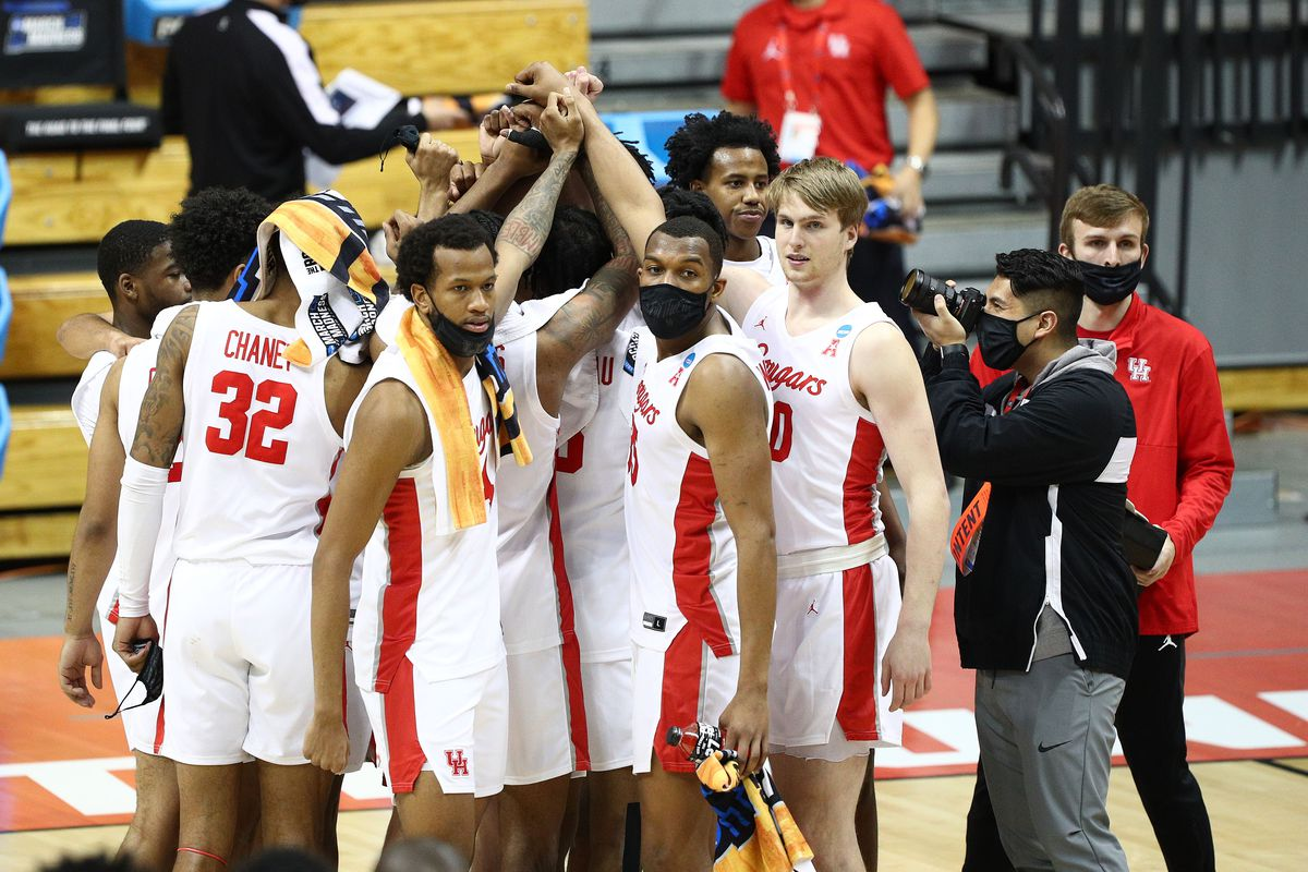 Houston Cougars celebrate the victory against the Cleveland State Vikings in the first round of the 2021 NCAA Tournament at Simon Skjodt Assembly Hall.