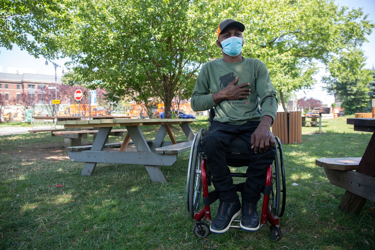 Refugee Saheed Adebayo Aare gets some fresh air near a Wards Island shelter where he has been living , July 27, 2020.