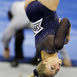 UCLA's Sam Peszek competes on the balance beam during the NCAA college women's individual gymnastics championships, Sunday, April 22, 2012, in Duluth, Ga.