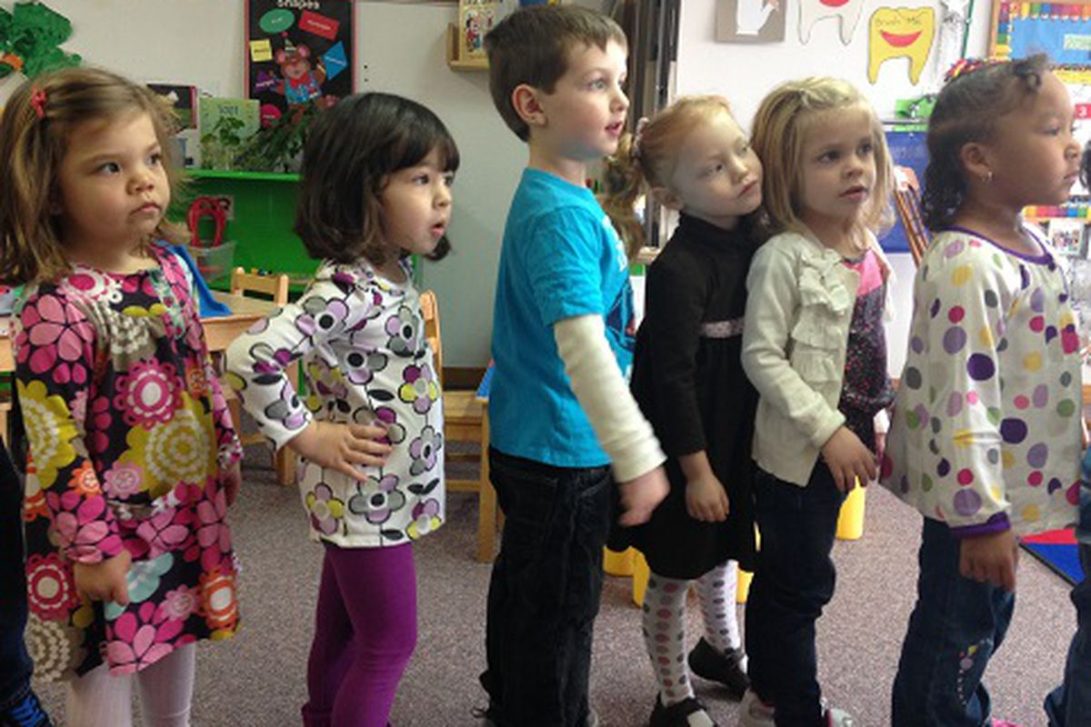 """Children in the """"3s"""" class at Promise Christian Preschool in Lafayette line up before circle time."""