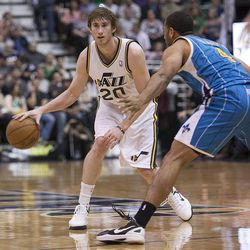 Utah's Gordon Hayward looks to pass as he is defended by New Orleans' Xavier Henry as the Utah Jazz and the New Orleans Hornets play Friday, April 5, 2013 at EnergySolutions Arena in Salt Lake City. Utah won 95-83.
