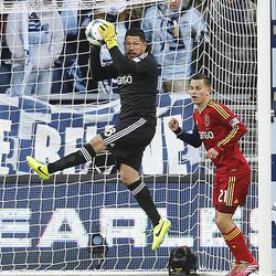 Real's Nick Rimando stops a shot as Real Salt Lake and Sporting KC play Saturday, Dec. 7, 2013 in MLS Cup action.