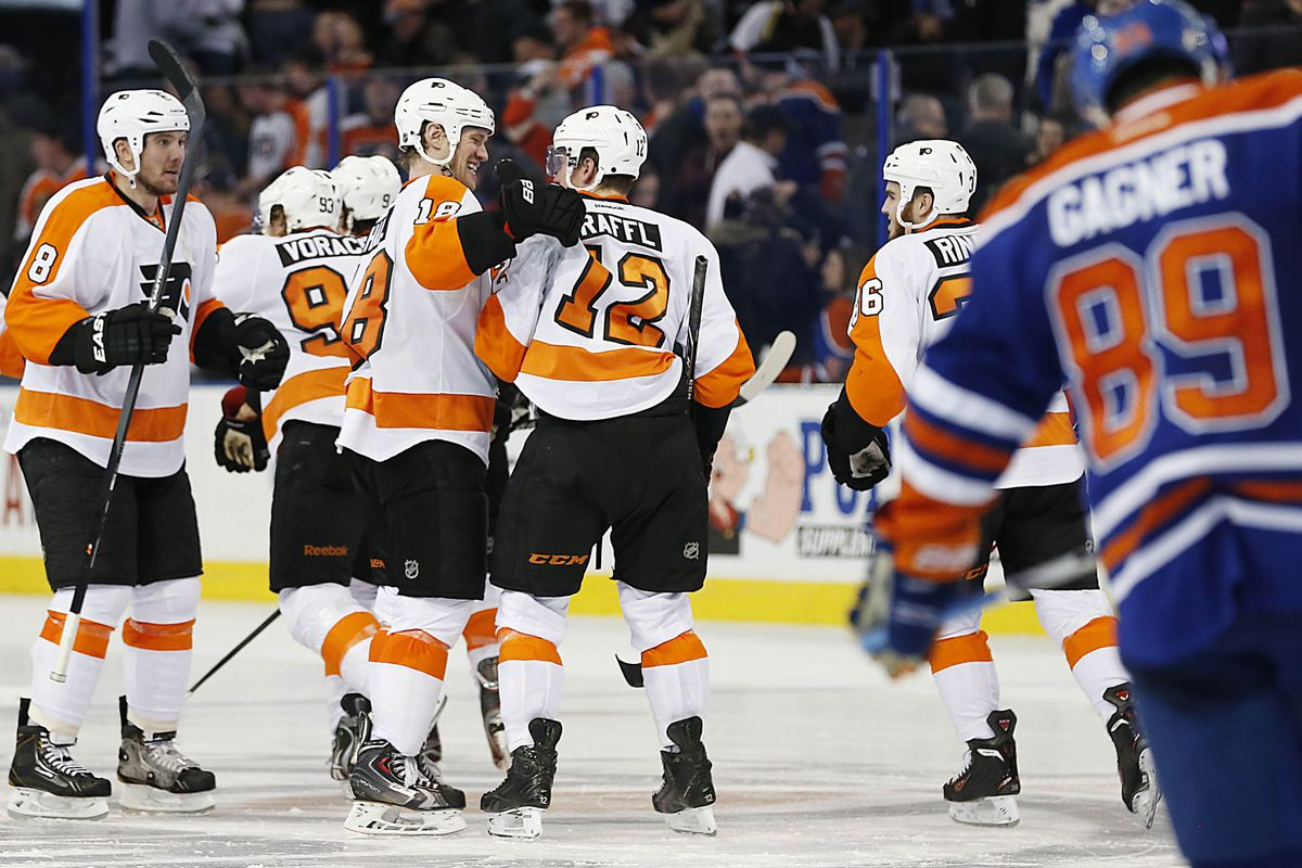 Flyers congratulate Raffl on the SO winner