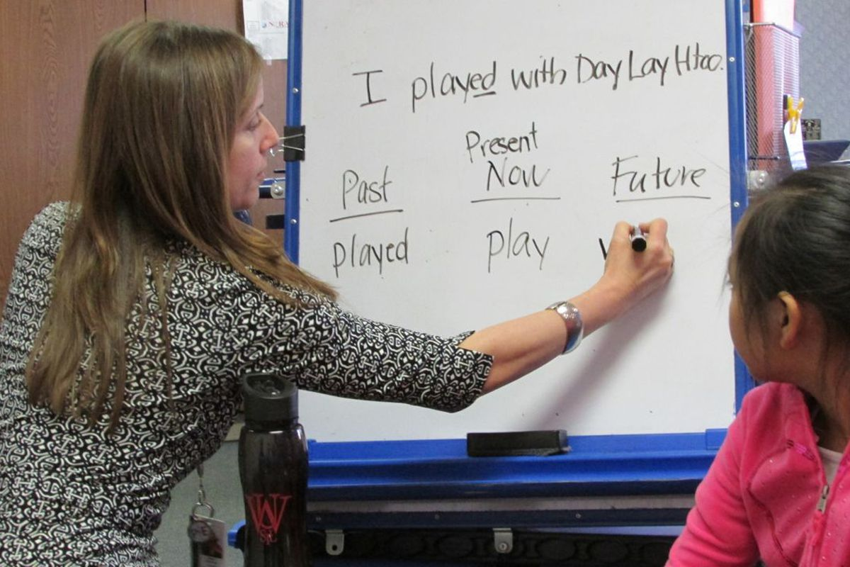 English language learning teacher Alison Fleischer works with refugee students in a small group at Nora Elementary School in Washington Township last year.