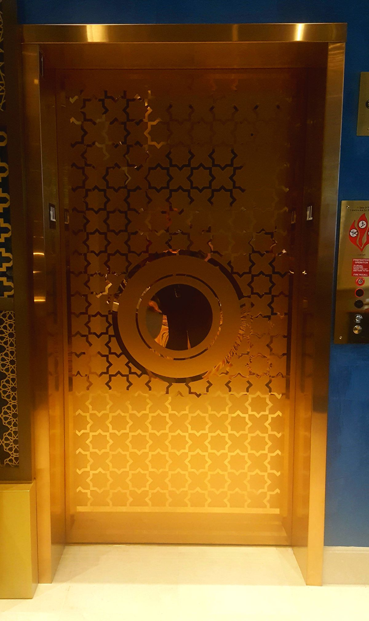 A photo of a gold elevator.