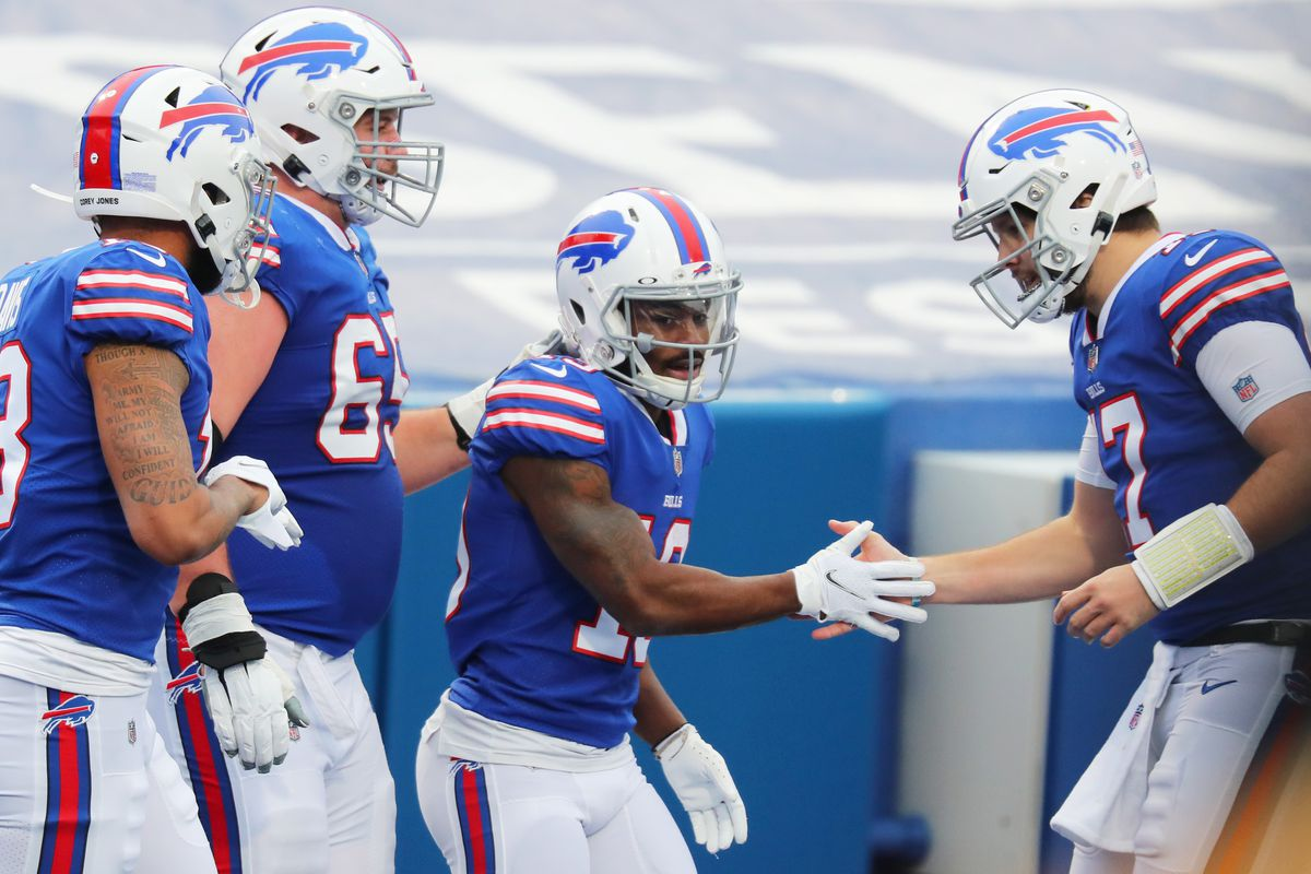 Isaiah McKenzie #19 of the Buffalo Bills celebrates a touchdown with Josh Allen #17 and Ike Boettger #65 in the second quarter against the Miami Dolphins at Bills Stadium on January 03, 2021 in Orchard Park, New York.