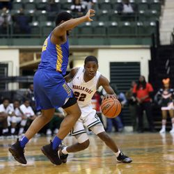 Morgan Park's Marcus Watson (22) dribbles around Simeon's Jeremiah Stamps (15) in CPS semi final action at Chicago State University, Friday, February 15, 2019. | Kevin Tanaka/For the Sun Times