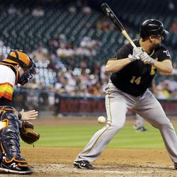 Pittsburgh Pirates' Gaby Sanchez (14) is hit by a pitch with the bases loaded as Houston Astros catcher Chris Snyder, left, reaches for the ball during the fifth inning of a baseball game, Sunday, Sept. 23, 2012, in Houston.