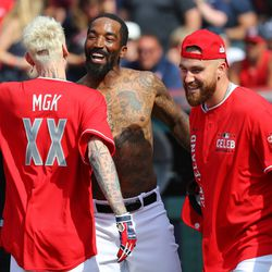 Rapper Machine Gun Kelly, J.R. Smith of the Cleveland Cavaliers, and Travis Kelce of the Kansas City Chiefs celebrate during the Legends & Celebrity Softball Game at Progressive Field on Sunday, July 7, 2019 in Cleveland, Ohio.