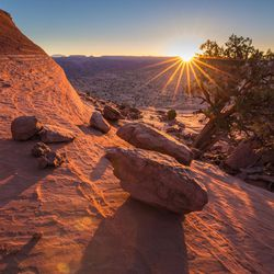 FILE - An undated photo of the sunrise above the Escalante River within Grand Staircase-Escalante National Monument. Interior Secretary Ryan Zinke released an executive summary of his findings from a 120-day review of 27 national monuments. The report says some monument designations clearly stretched definitions in the 1906 Antiquities Law, but it lacks specifics.
