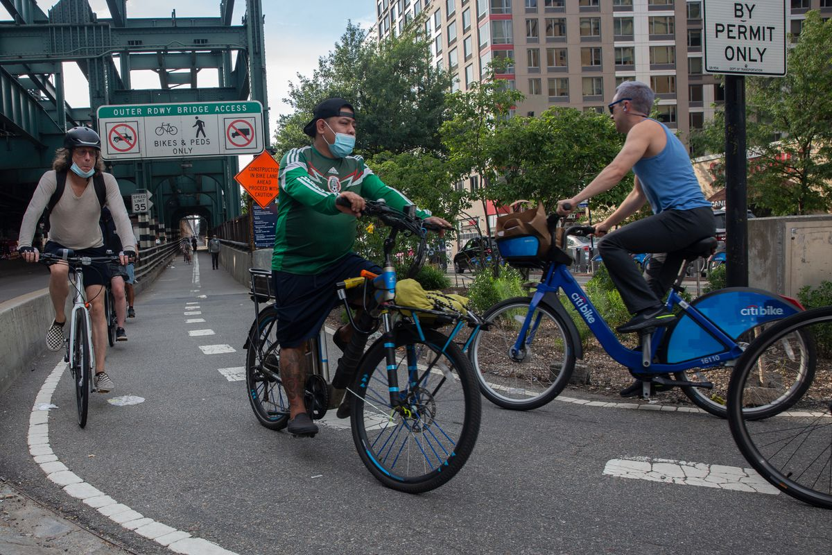 Cyclists ride over the Queensboro Bridge, Aug. 3, 2020.