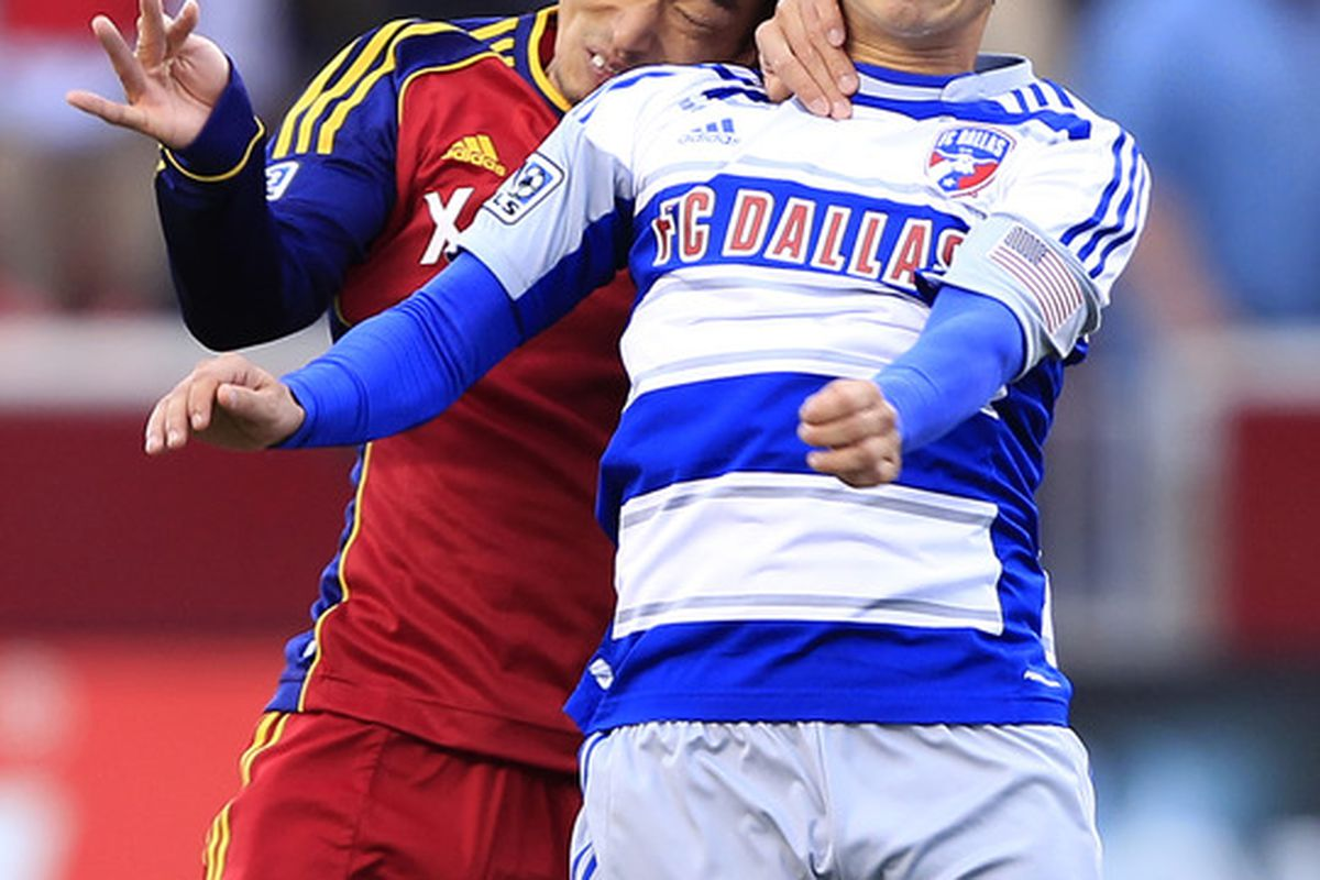 SANDY, UT - MAY 26: Terukazu Tanaka #53 of Real Salt Lake and Bryan Leyva #21 of FC Dallas fight for the ball during the first half of an MLS soccer game May 26, 2012 at Rio Tinto Stadium in Sandy, Utah. (Photo by George Frey/Getty Images)