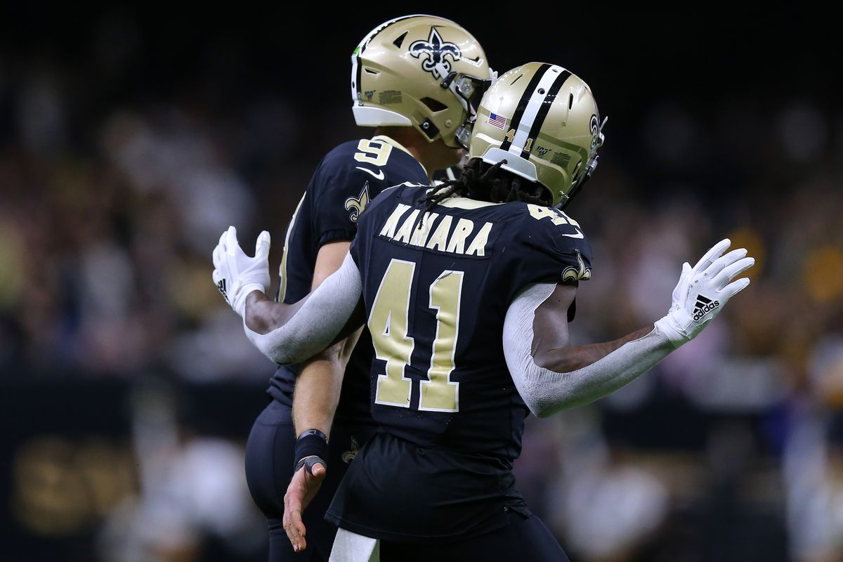 Drew Brees of the New Orleans Saints and Alvin Kamara during a game against the Carolina Panthers at the Mercedes Benz Superdome on November 24, 2019 in New Orleans, Louisiana.