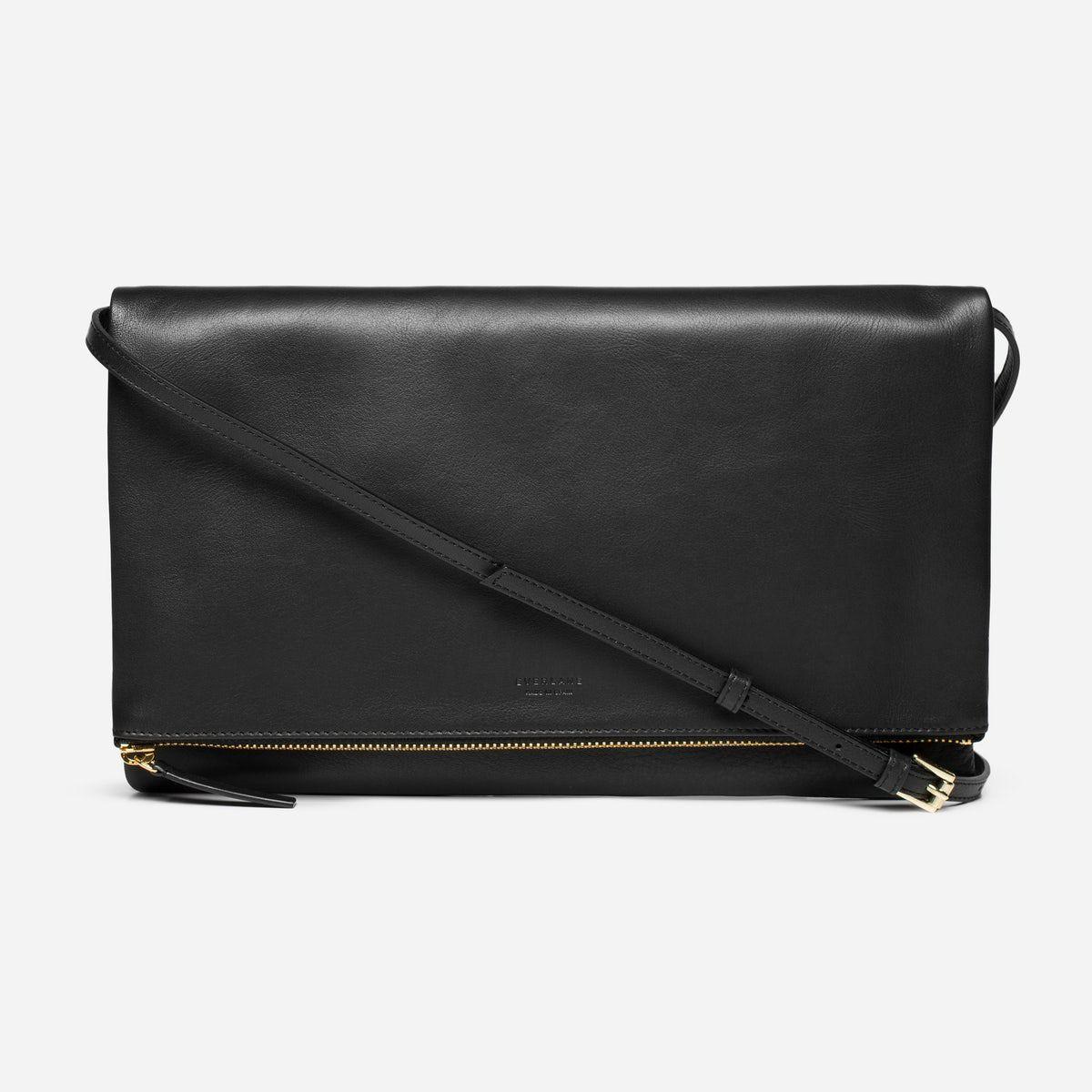 A black foldover bag