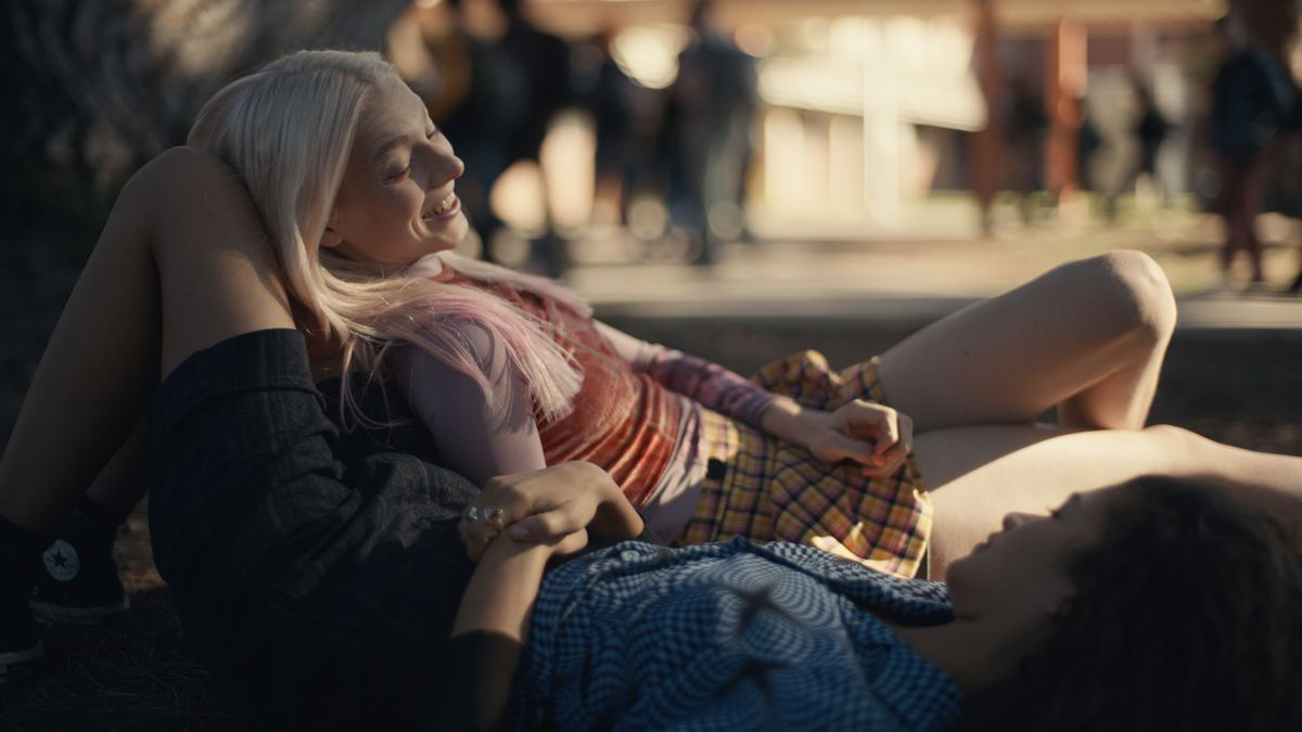 on Euphoria, two girls are lying on the grass together. They're both smiling, although you can really only see the blond girl laying on the brown-haired girl's knees. They're obviously very physically familiar with each other.