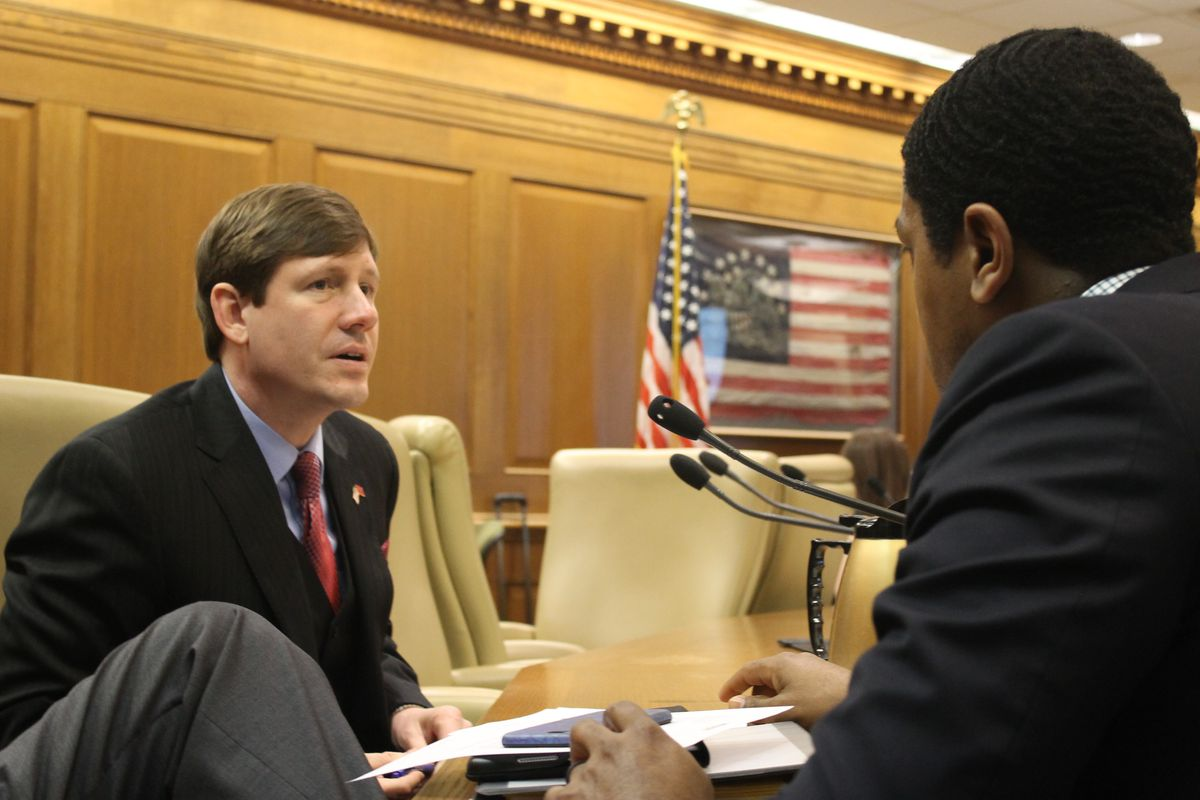 State Sen. Brian Kelsey of Germantown (left) confers with someone before the Senate Education Committee voted March 7 to advance his Memphis-specific voucher bill.