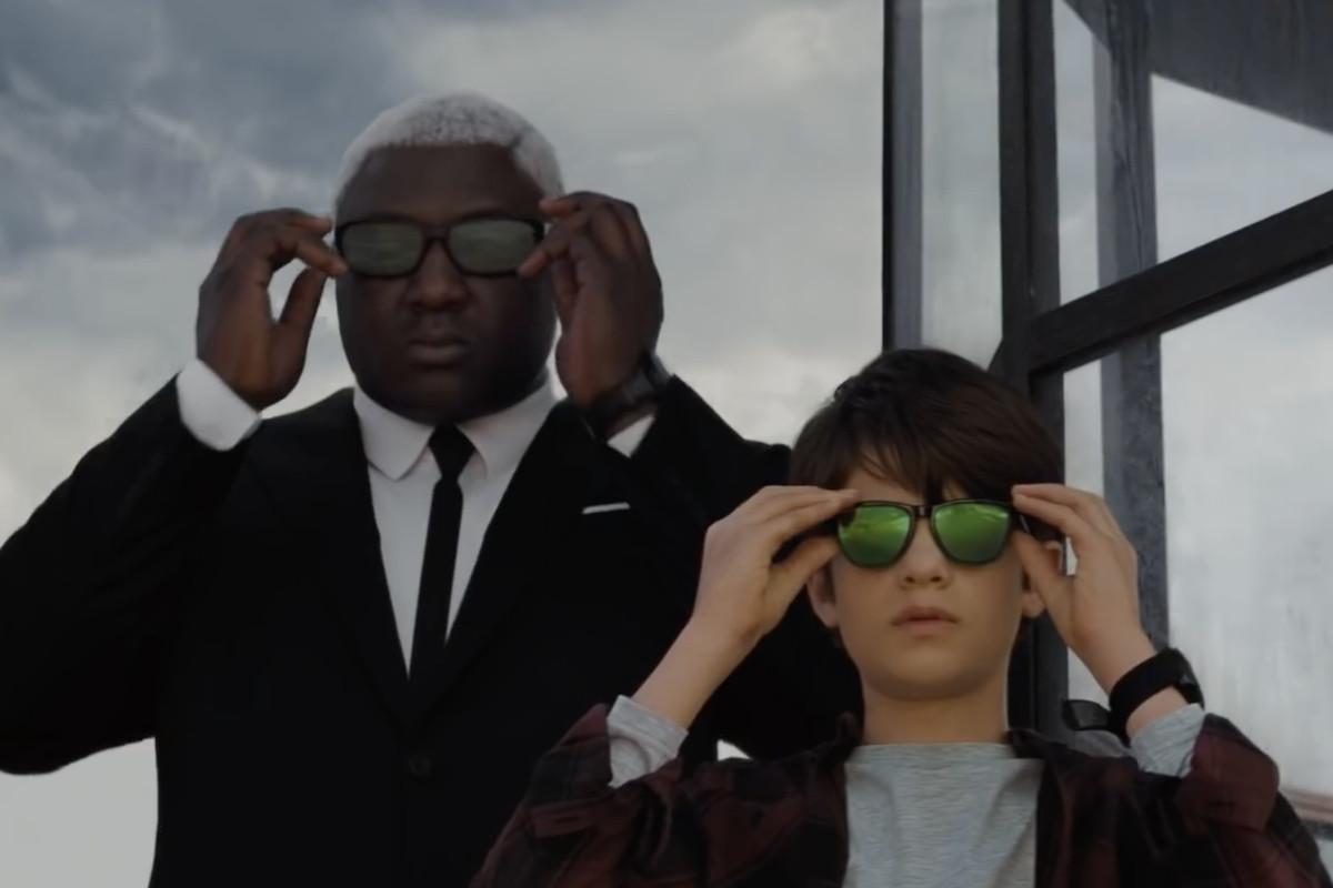 artemis tries on some sunglasses