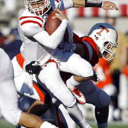 East's Quarterback #8 Jason Cook fights for more yardage as East and Timpview play Thursday, Nov. 10, 2011 in the 4A semifinal game at Rice Eccles stadium in Salt Lake City.