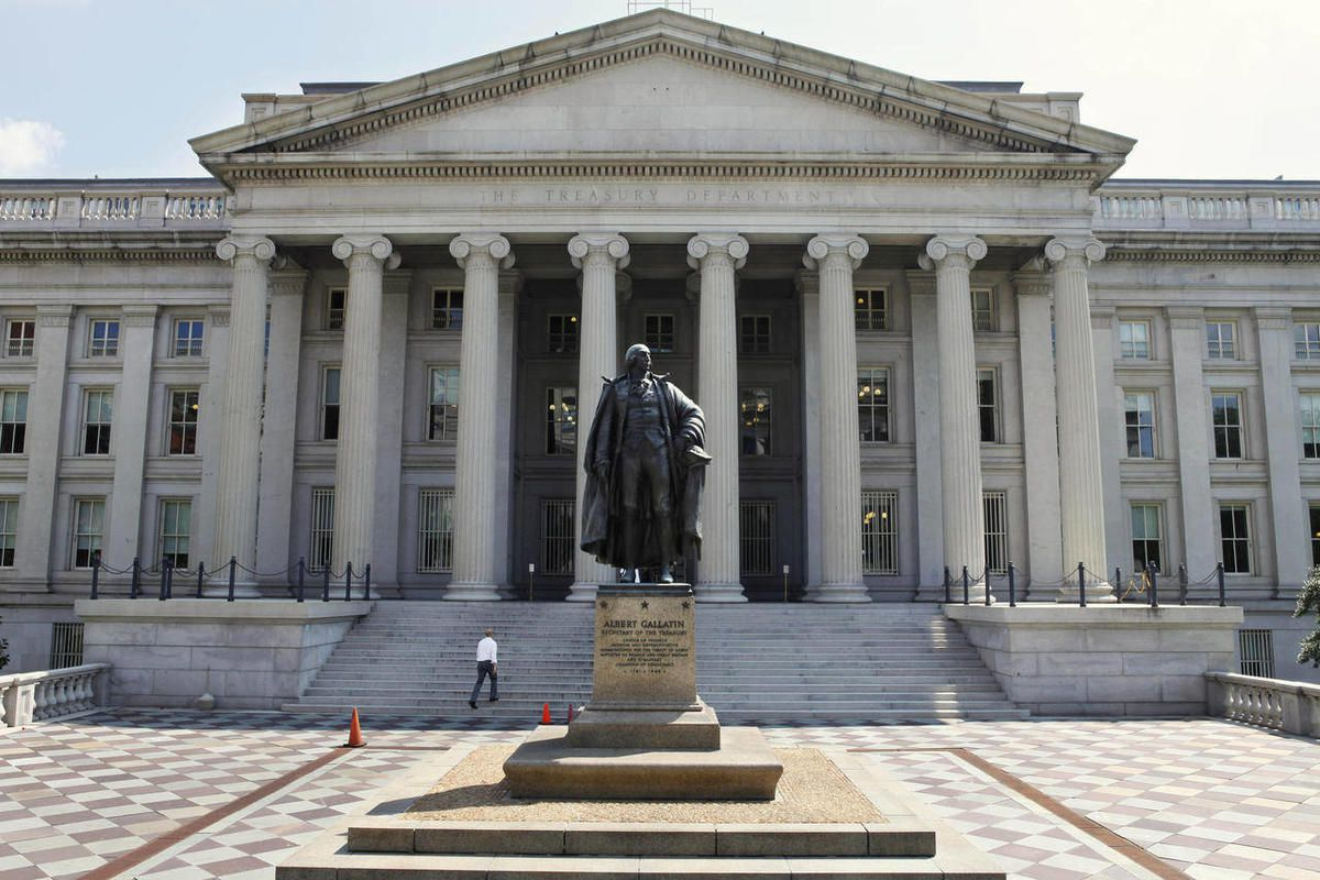 In this Monday, Aug. 8, 2011 file photo, a statue of former Treasury Secretary Albert Gallatin stands guard outside the Treasury Building in Washington.