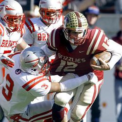 Quarterback DJ Nelson #12 ,right, is tackled by Bountiful's #3 Rylee Gautaval on a run up the middle of the defence as Logan and Bountiful play Thursday, Nov. 10, 2011 in the 4A semifinal game at Rice Eccles stadium in Salt Lake City. Logan won 59-30.