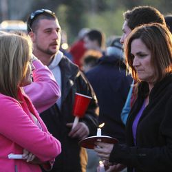 Area residents gather at the Town Hall, Friday, April 13, 2012 in Greenland, N.H. for a candle-light vigil to honor slain Police Chief Michael Maloney. Maloney was trying to serve a search warrant Thursday night when a suspect opened fire, killing the 48-year-old chief, injuring four officers from other departments, and plunging the southeastern New Hampshire community of Greenland into a grief that residents say they won't soon get over.