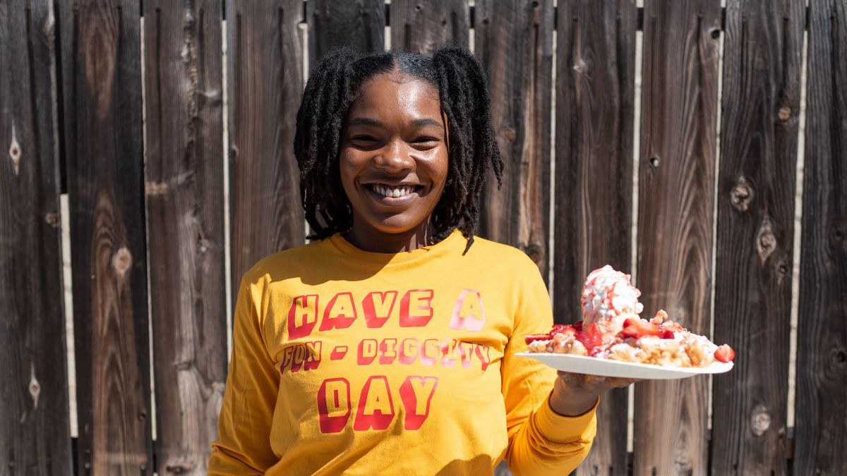 Cheyenne Brown holding a loaded funnel cake